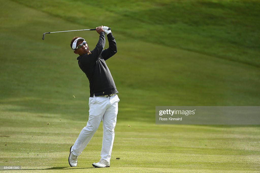 Thongchai Jaidee of Thailand hits his approach on the 7th hole during day one of the BMW PGA Championship at Wentworth on May 26, 2016 in Virginia Water, England.