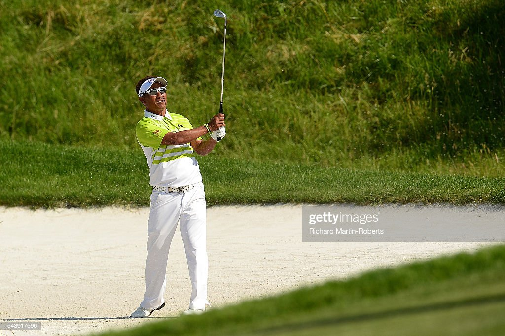<a gi-track='captionPersonalityLinkClicked' href=/galleries/search?phrase=Thongchai+Jaidee&family=editorial&specificpeople=200733 ng-click='$event.stopPropagation()'>Thongchai Jaidee</a> of Thailand hits his approach to the 14th green during the first round of the 100th Open de France at Le Golf National on June 30, 2016 in Paris, France.