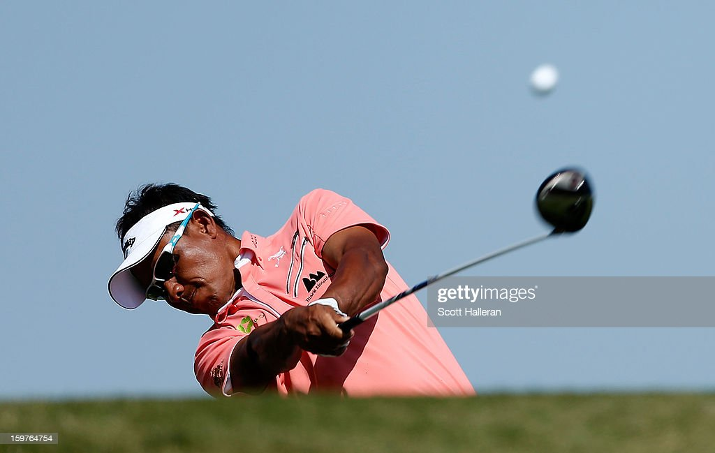 Thongchai Jaidee of Thailand hits his tee shot on the third hole during the final round of the Abu Dhabi HSBC Golf Championship at Abu Dhabi Golf Club on January 20, 2013 in Abu Dhabi, United Arab Emirates.