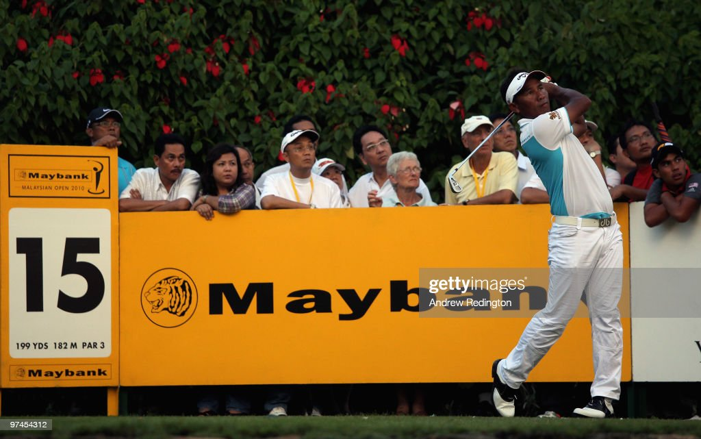 Thongchai Jaidee of Thailand hits his teeshot on the 15th hole during the the second round of the Maybank Malaysian Open at the Kuala Lumpur Golf and...