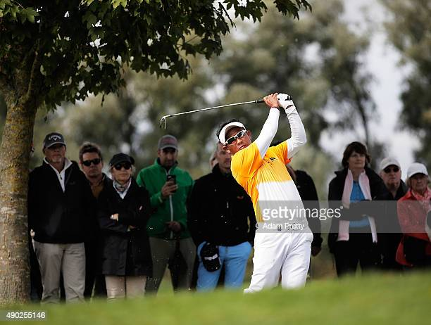 Thongchai Jaidee of Thailand hits out of the rough on hole 3 during the final round of the Porsche European Open at Golf Resort Bad Griesbach on...