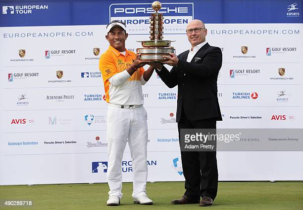 Thongchai Jaidee of Thailand is presented with the winners trophy by Bernhard Maier member of the board sales and marketing Porsche AG after victory...