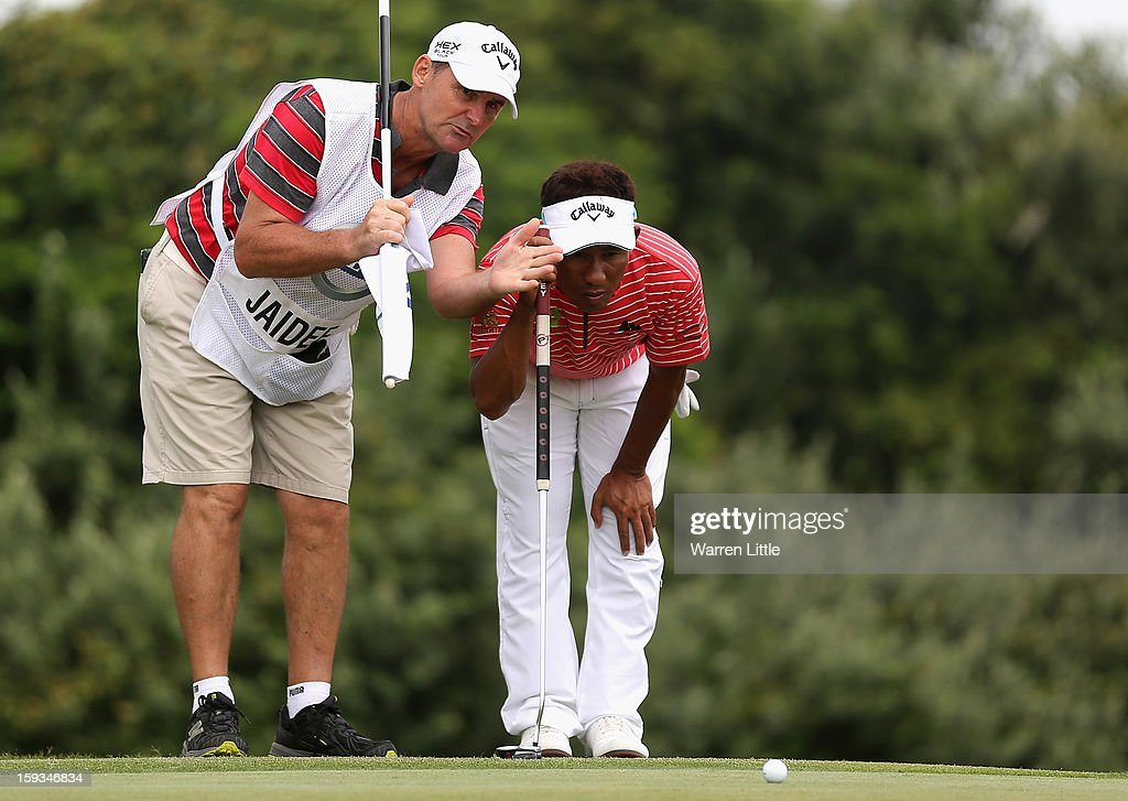 <a gi-track='captionPersonalityLinkClicked' href=/galleries/search?phrase=Thongchai+Jaidee&family=editorial&specificpeople=200733 ng-click='$event.stopPropagation()'>Thongchai Jaidee</a> of Thailand lines up a putt on the 12th green during the third round of the Volvo Golf Champions at Durban Country Club on January 12, 2013 in Durban, South Africa.