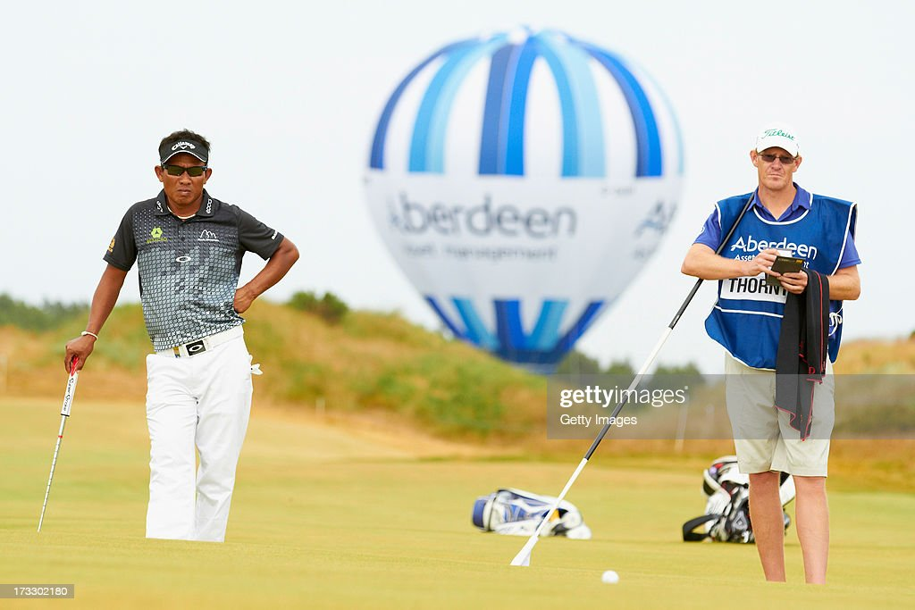 <a gi-track='captionPersonalityLinkClicked' href=/galleries/search?phrase=Thongchai+Jaidee&family=editorial&specificpeople=200733 ng-click='$event.stopPropagation()'>Thongchai Jaidee</a> of Thailand looks on during the first round of the Aberdeen Asset Management Scottish Open at Castle Stuart Golf Links on July 11, 2013 in Inverness, Scotland.