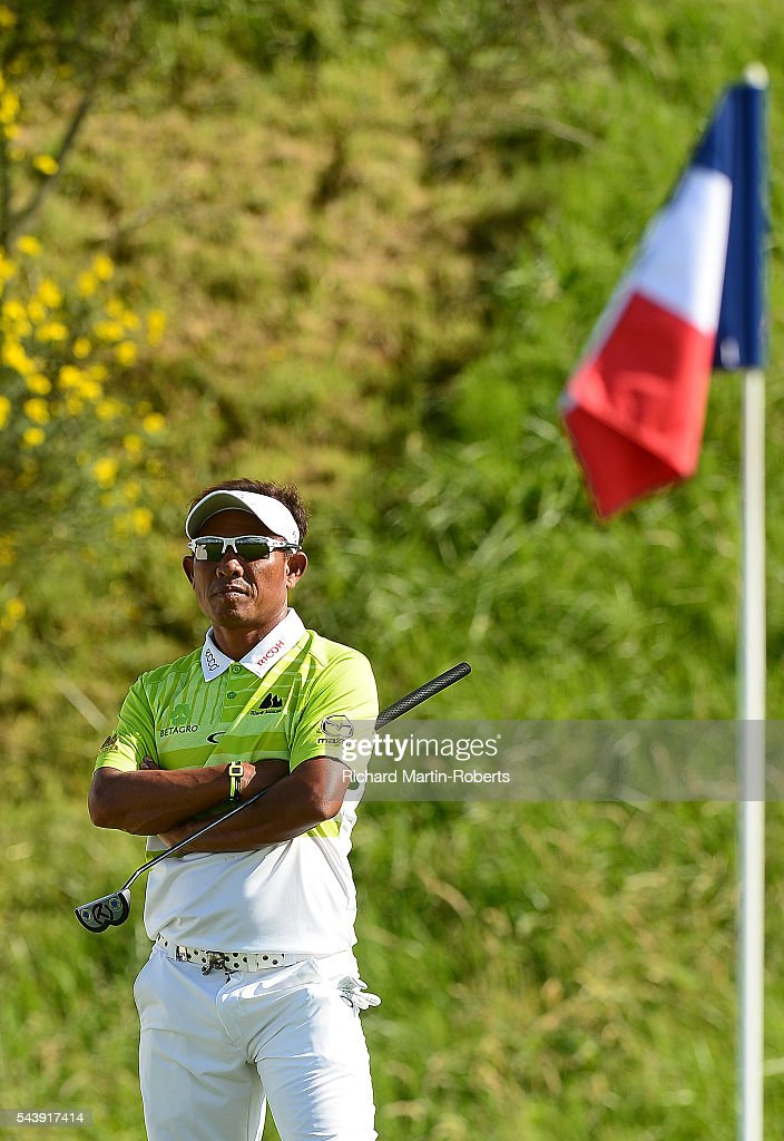 <a gi-track='captionPersonalityLinkClicked' href=/galleries/search?phrase=Thongchai+Jaidee&family=editorial&specificpeople=200733 ng-click='$event.stopPropagation()'>Thongchai Jaidee</a> of Thailand looks on during the first round of the 100th Open de France at Le Golf National on June 30, 2016 in Paris, France.