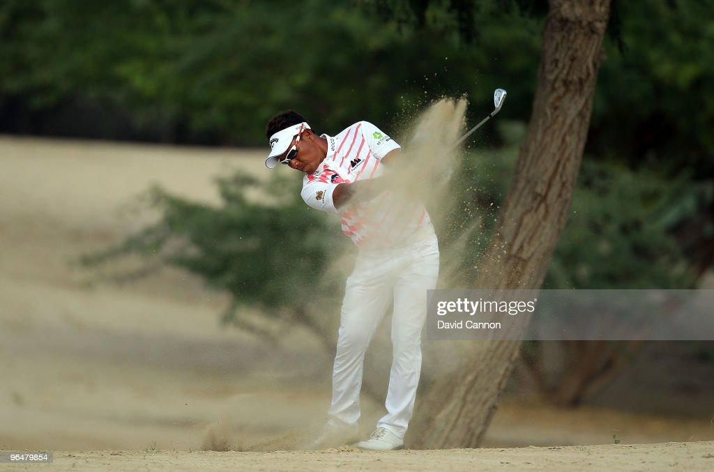Thongchai Jaidee of Thailand plays his second shot at the 14th hole during the final round of the 2010 Omega Dubai Desert Classic on the Majilis...