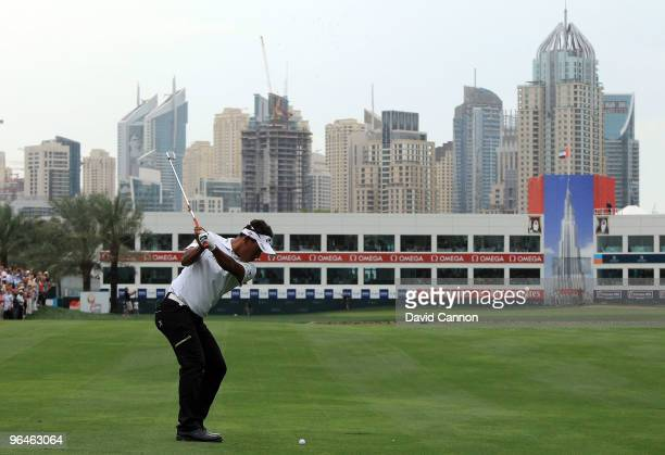 Thongchai Jaidee of Thailand plays his second shot at the 18th hole during the third round of the 2010 Omega Dubai Desert Classic on the Majilis...
