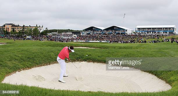 Thongchai Jaidee of Thailand plays his second shot from a bunker on the 18th hole during day four of the 100th Open de France at Le Golf National on...