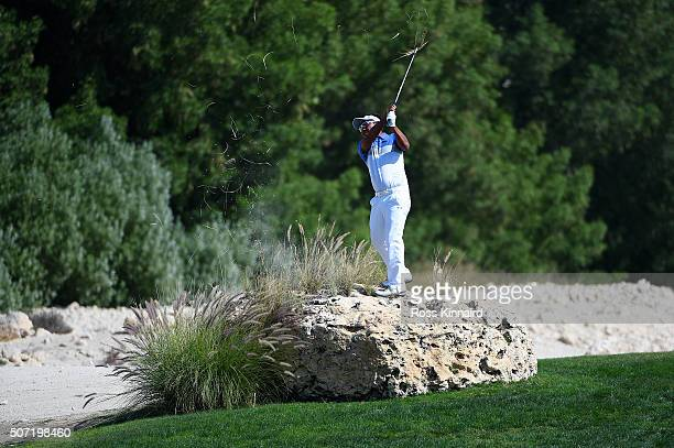Thongchai Jaidee of Thailand plays his second shot from the top of a rock on the 4th during the second round of the Commercial Bank Qatar Masters at...