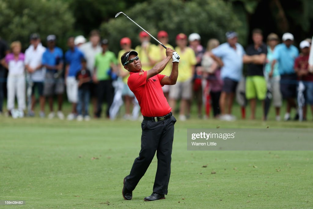 <a gi-track='captionPersonalityLinkClicked' href=/galleries/search?phrase=Thongchai+Jaidee&family=editorial&specificpeople=200733 ng-click='$event.stopPropagation()'>Thongchai Jaidee</a> of Thailand plays his second shot on the sixth hole during the final round of the Volvo Golf Champions at Durban Country Club on January 13, 2013 in Durban, South Africa.