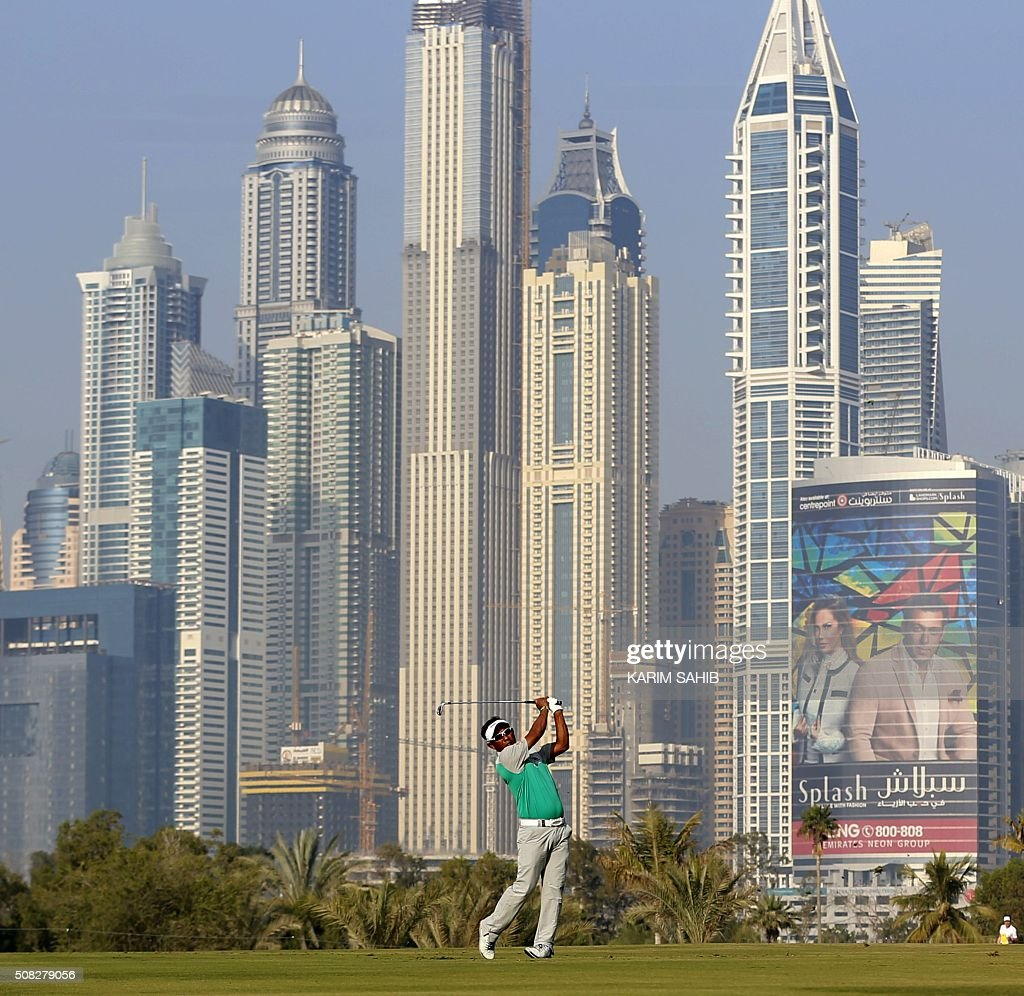 Thongchai Jaidee of Thailand plays his third shot during the first round of the 2016 Dubai Desert Classic at the Emirates Golf Club on February 4, 2016 in Dubai. / AFP / KARIM