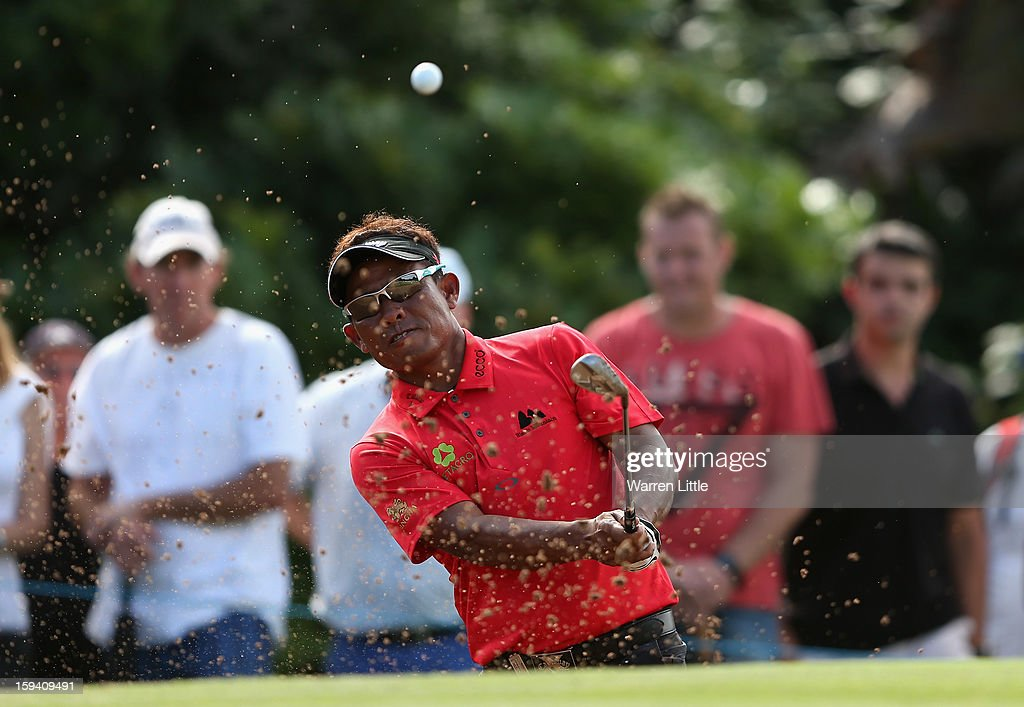 <a gi-track='captionPersonalityLinkClicked' href=/galleries/search?phrase=Thongchai+Jaidee&family=editorial&specificpeople=200733 ng-click='$event.stopPropagation()'>Thongchai Jaidee</a> of Thailand plays out of the 14th greenside bunker during the final round of the Volvo Golf Champions at Durban Country Club on January 13, 2013 in Durban, South Africa.