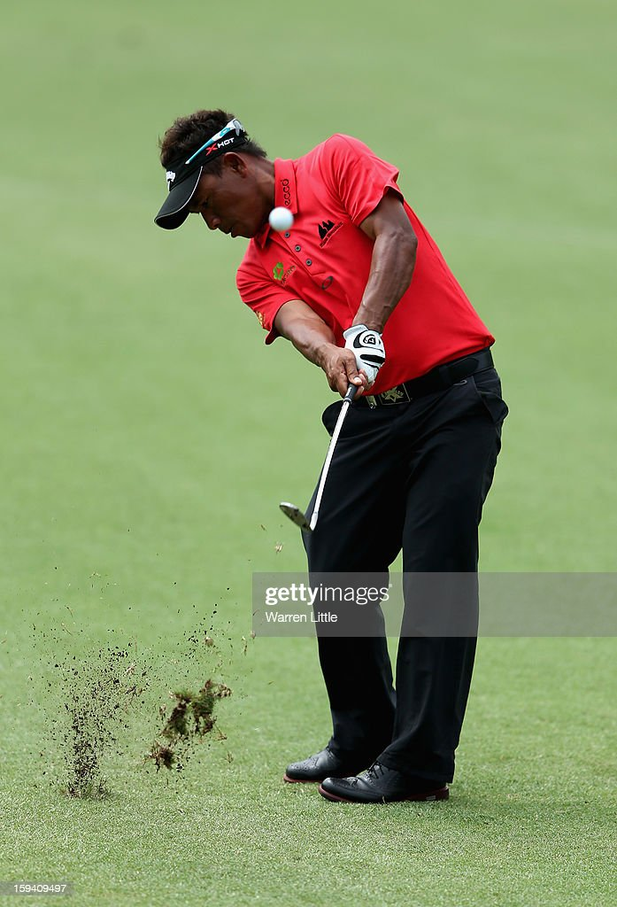 <a gi-track='captionPersonalityLinkClicked' href=/galleries/search?phrase=Thongchai+Jaidee&family=editorial&specificpeople=200733 ng-click='$event.stopPropagation()'>Thongchai Jaidee</a> of Thailand plays second shot on the 17th hole during the final round of the Volvo Golf Champions at Durban Country Club on January 13, 2013 in Durban, South Africa.