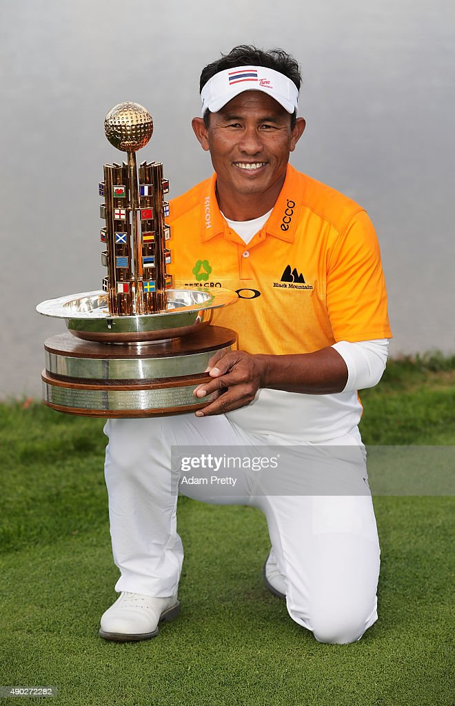 <a gi-track='captionPersonalityLinkClicked' href=/galleries/search?phrase=Thongchai+Jaidee&family=editorial&specificpeople=200733 ng-click='$event.stopPropagation()'>Thongchai Jaidee</a> of Thailand poses with the winners trophy after victory in the final round of the Porsche European Open at Golf Resort Bad Griesbach on September 27, 2015 in Passau, Germany.