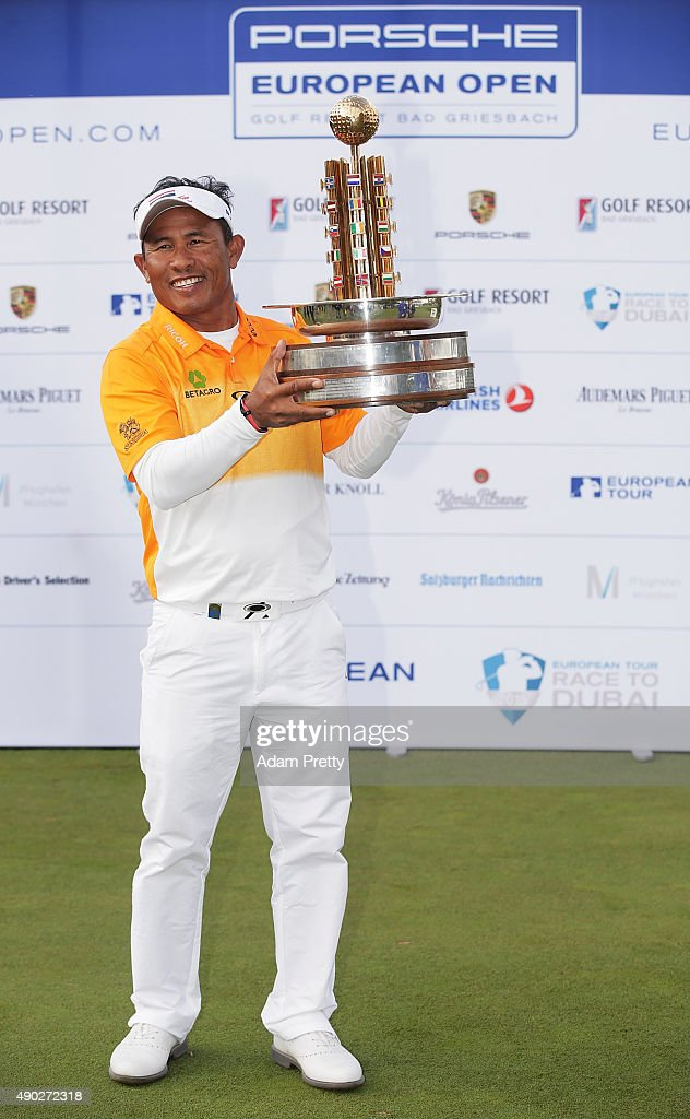 Thongchai Jaidee of Thailand poses with the winners trophy after victory in the final round of the Porsche European Open at Golf Resort Bad Griesbach...