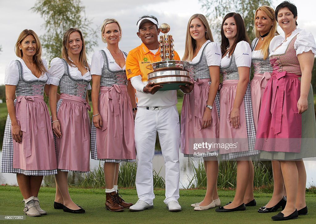 Thongchai Jaidee of Thailand poses with the winners trophy and some hostesses after victory in the final round of the Porsche European Open at Golf...