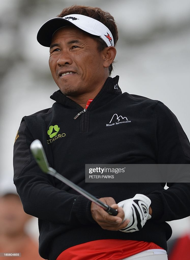 Thongchai Jaidee of Thailand tees off at the second hole during the second round of the BMW Shanghai Masters golf tournament at the Lake Malaren Golf Club in Shanghai on October 25, 2013. AFP PHOTO/Peter PARKS