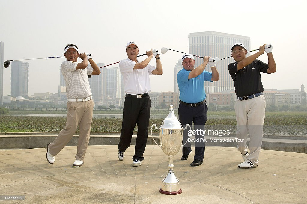 <a gi-track='captionPersonalityLinkClicked' href=/galleries/search?phrase=Thongchai+Jaidee&family=editorial&specificpeople=200733 ng-click='$event.stopPropagation()'>Thongchai Jaidee</a> of Thailand, Zhang Lian-wei of China, <a gi-track='captionPersonalityLinkClicked' href=/galleries/search?phrase=Ian+Woosnam&family=editorial&specificpeople=457974 ng-click='$event.stopPropagation()'>Ian Woosnam</a> of Wales and Chan Yih-shin of Chinese Taipei stand for a photograph ahead of the Venetian Macau Open at Macau Golf & Country Club on October 9, 2012 in Macau.