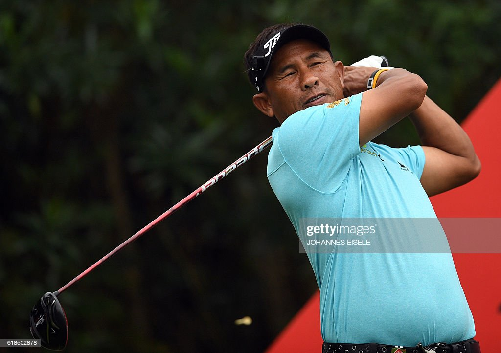 Thongchai Jaideee of Thailand tees off at the World Golf Championships-HSBC Champions golf tournament in Shanghai on October 27, 2016. / AFP / JOHANNES