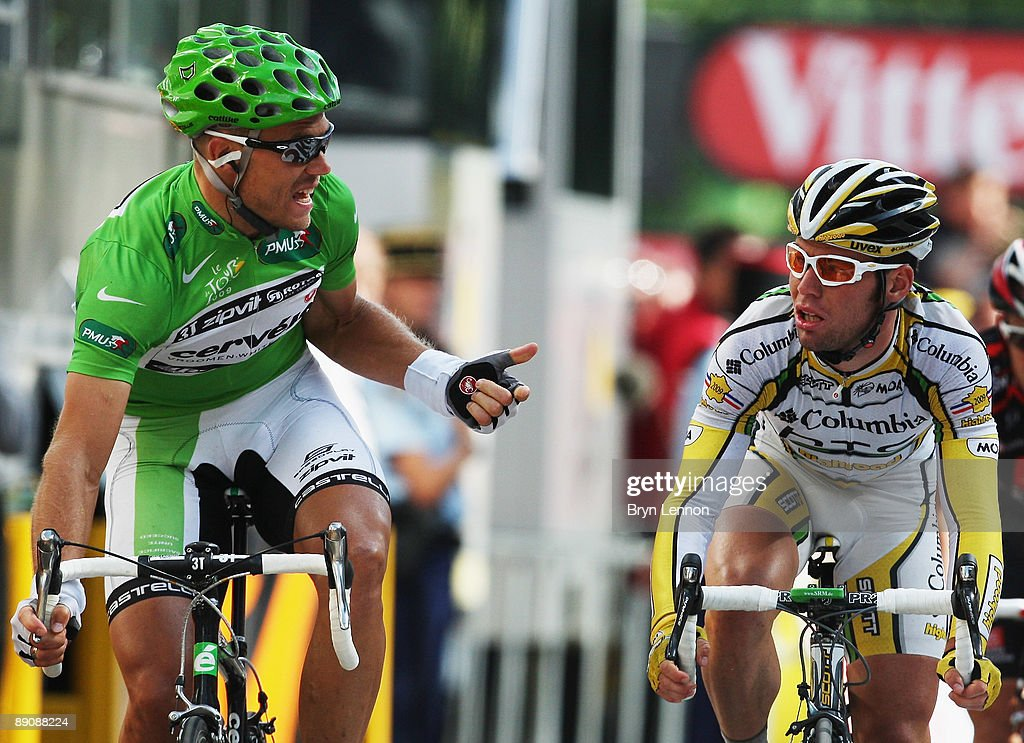 Thor Hushovd (l) of Norway and the Cervelo Test Team complains to Mark Cavendish of Great Britain and Columbia-HTC after the bunch sprint on stage 14 of the 2009 Tour de France from Colmar to Besancon on July 18, 2009 in Besancon, France. Cavendish was disqalified by race commisaires for straying from the sprinters line.