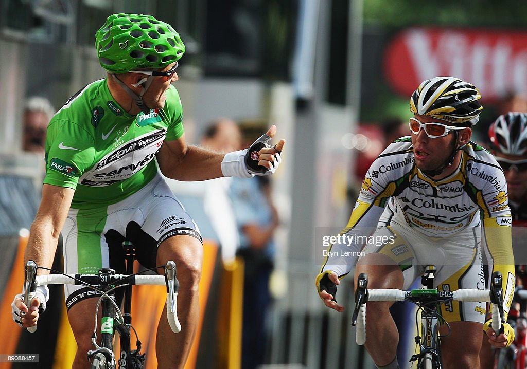 Thor Hushovd (L) of Norway and the Cervelo Test Team complains to Mark Cavendish of Great Britain and Columbia-HTC after the bunch sprint on stage 14 of the 2009 Tour de France from Colmar to Besancon on July 18, 2009 in Besancon. Cavendish was disqualified by race commisaires for straying from the sprinters line.