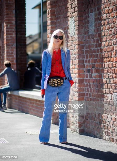 Thora Valdimars wearing Gucci belt bag red cardigan blue suit is seen outside Gucci during Milan Fashion Week Spring/Summer 2018 on September 20 2017...