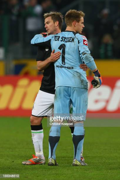 Thorben Marx and MarcAndre ter Stegen of Moenchengladbach look dejected after the Bundesliga match between VfL Borussia Moenchengladbach and SC...