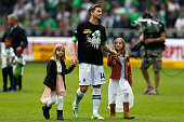 Thorben Marx of Borussia Moenchengladbach with his children thanks the fans after the Bundesliga match between Borussia Moenchengladbach and FC...