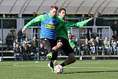 Thorben Marx of Borussia Monchengladbach and Martin Stranzl of Borussia Monchengladbach battle for the ball during a training session at day two of...