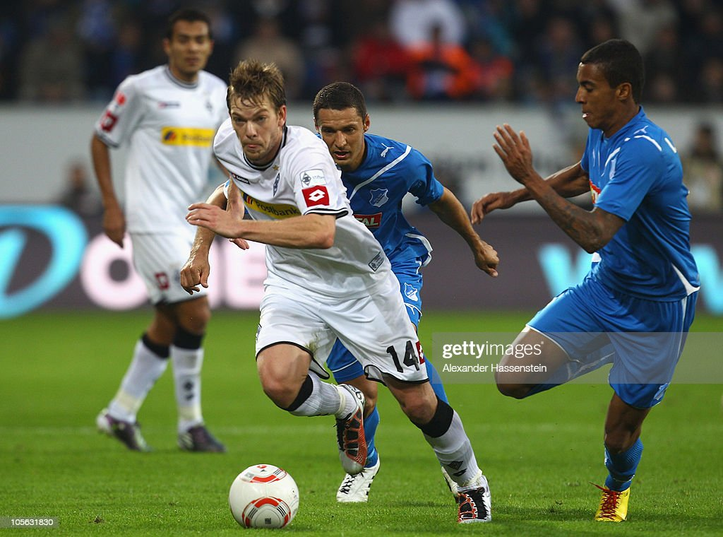 Thorben Marx (C) of Gladbach battles for the ball with Luiz Gustavo (R) of Hoffenheim during the Bundesliga match between 1899 Hoffenheim and Borussia Moenchengladbach at Rhein-Neckar Arena on October 17, 2010 in Sinsheim, Germany.