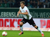 Thorben Marx of Gladbach runs with the ball during the Bundesliga match between Werder Bremen and Borussia Moenchengladbach at Weser Stadium on...