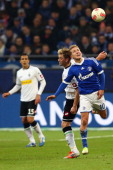 Thorben Marx of Moenchengladbach and Lewis Holtby of Schalke go up for a header during the Bundesliga match between FC Schalke 04 and Borussia...
