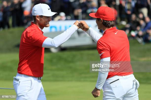 Thorbjorn Olesen and Lucas Bjerregaard of Denmark celebrate victory on the 6th green during the semi final match between Italy and Denmark during day...