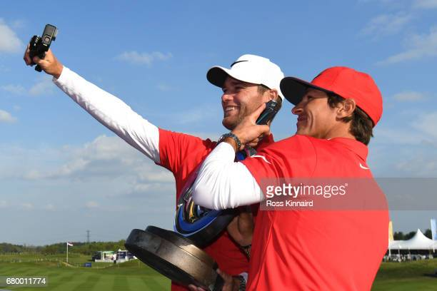 Thorbjorn Olesen and Lucas Bjerregaard of Denmark pose for a picture with the trophy after winning the final match between Denmark and Australia...