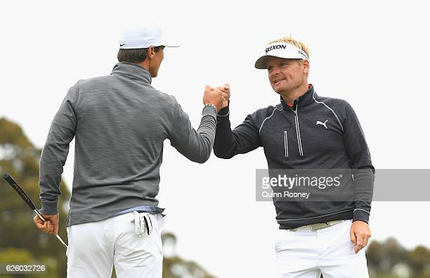 Thorbjorn Olesen and Soren Kjeldsen of Denmark celebrate a birdie during day four of the World Cup of Golf at Kingston Heath Golf Club on November 27...