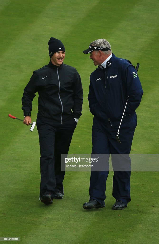 <a gi-track='captionPersonalityLinkClicked' href=/galleries/search?phrase=Thorbjorn+Olesen&family=editorial&specificpeople=6545194 ng-click='$event.stopPropagation()'>Thorbjorn Olesen</a> of Denmark and <a gi-track='captionPersonalityLinkClicked' href=/galleries/search?phrase=Darren+Clarke&family=editorial&specificpeople=171309 ng-click='$event.stopPropagation()'>Darren Clarke</a> of Northern Ireland share a joke as they walk down the eighteenth fairway during the second round of the BMW PGA Championship on the West Course at Wentworth on May 24, 2013 in Virginia Water, England.