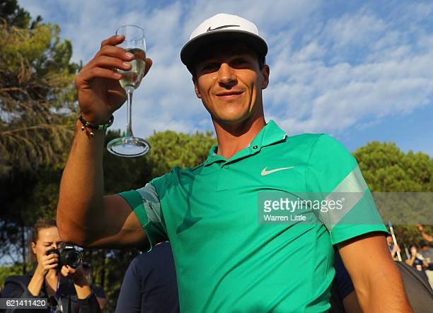 Thorbjorn Olesen of Denmark celebrates with champagne following his victory during day four of the Turkish Airlines Open at the Regnum Carya Golf Spa...