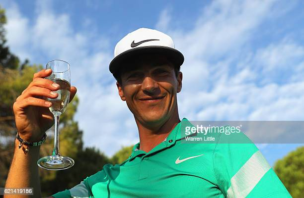 Thorbjorn Olesen of Denmark celebrates with champagne following his victory during the final round of the Turkish Airlines Open at the Regnum Carya...