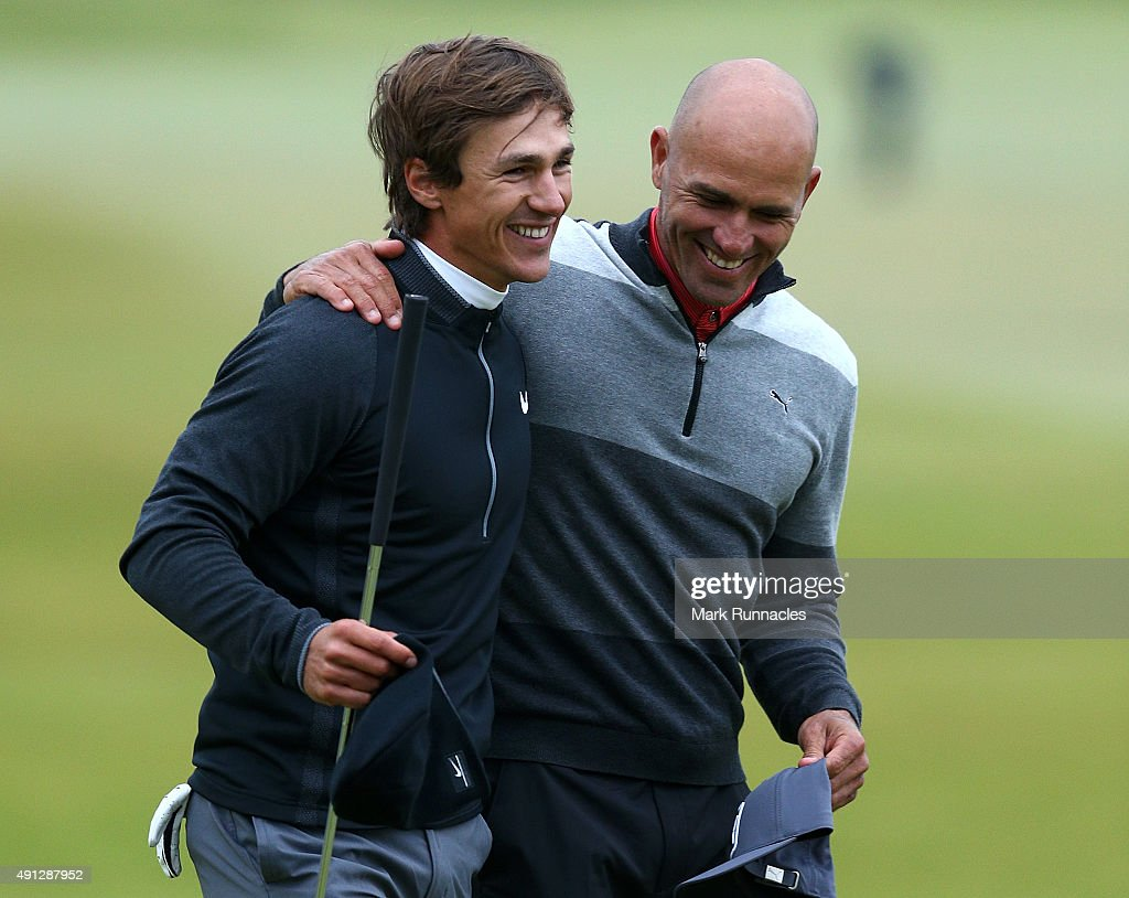 Thorbjorn Olesen of Denmark celebrates with his playing partner Kelly Slater on the 18th green after victory in the 2015 Alfred Dunhill Links...