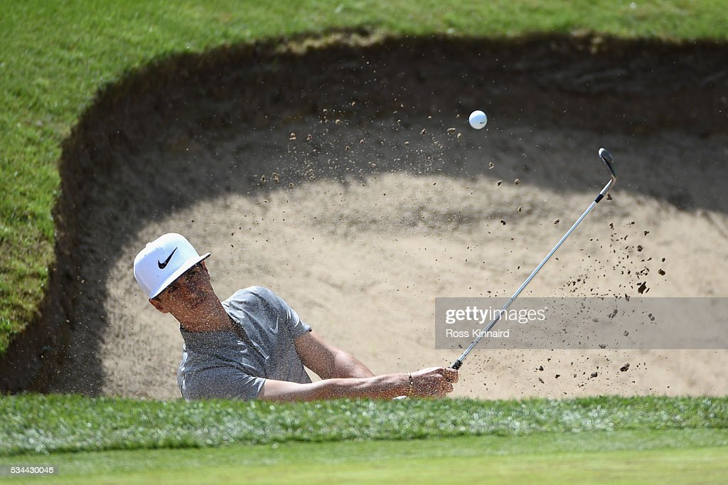 <a gi-track='captionPersonalityLinkClicked' href=/galleries/search?phrase=Thorbjorn+Olesen&family=editorial&specificpeople=6545194 ng-click='$event.stopPropagation()'>Thorbjorn Olesen</a> of Denmark hits his 3rd shot on the 18th hole during day one of the BMW PGA Championship at Wentworth on May 26, 2016 in Virginia Water, England.