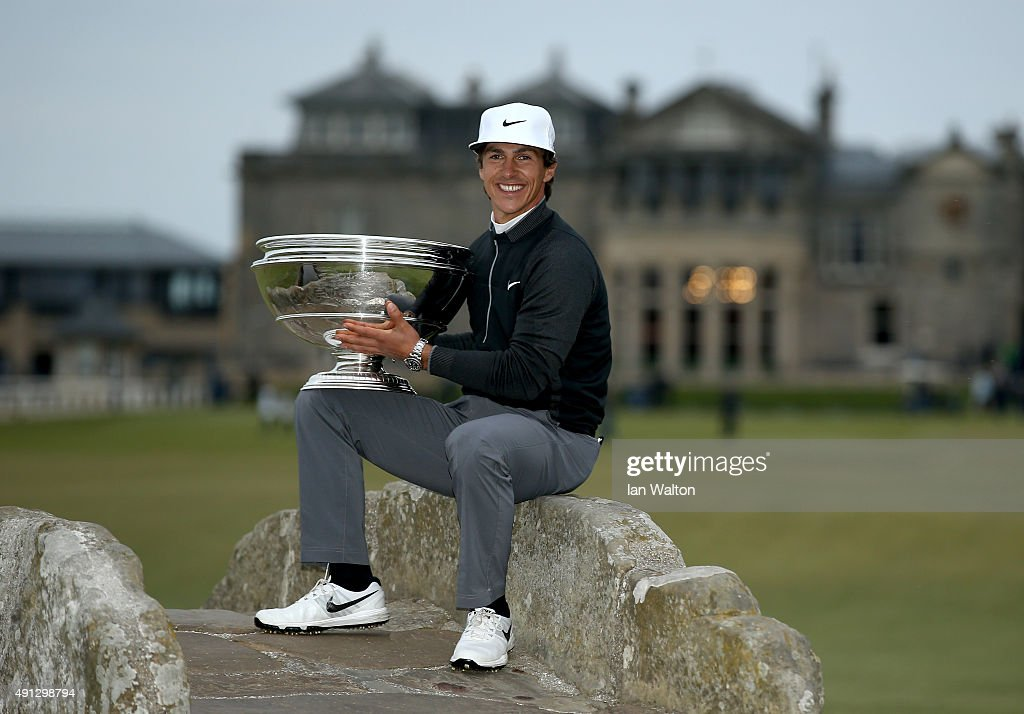 <a gi-track='captionPersonalityLinkClicked' href=/galleries/search?phrase=Thorbjorn+Olesen&family=editorial&specificpeople=6545194 ng-click='$event.stopPropagation()'>Thorbjorn Olesen</a> of Denmark holds the trophy aloft on the Swilcan Bridge on the 18th hole after victory in the 2015 Alfred Dunhill Links Championship at The Old Course on October 4, 2015 in St Andrews, Scotland.