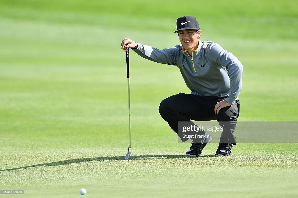 <a gi-track='captionPersonalityLinkClicked' href=/galleries/search?phrase=Thorbjorn+Olesen&family=editorial&specificpeople=6545194 ng-click='$event.stopPropagation()'>Thorbjorn Olesen</a> of Denmark lines up a putt during the rain delayed third round of the BMW International Open at Gut Larchenhof on June 26, 2016 in Cologne, Germany.