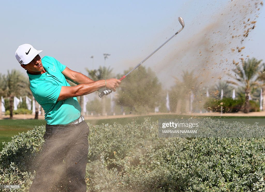 Thorbjorn Olesen of Denmark plays a shot during the final round of the Abu Dhabi Golf Championship at the Abu Dhabi Golf Club in the Emirati capital on January 20, 2013. Jamie Donaldson reeled in red-hot Justin Rose to win the championship.