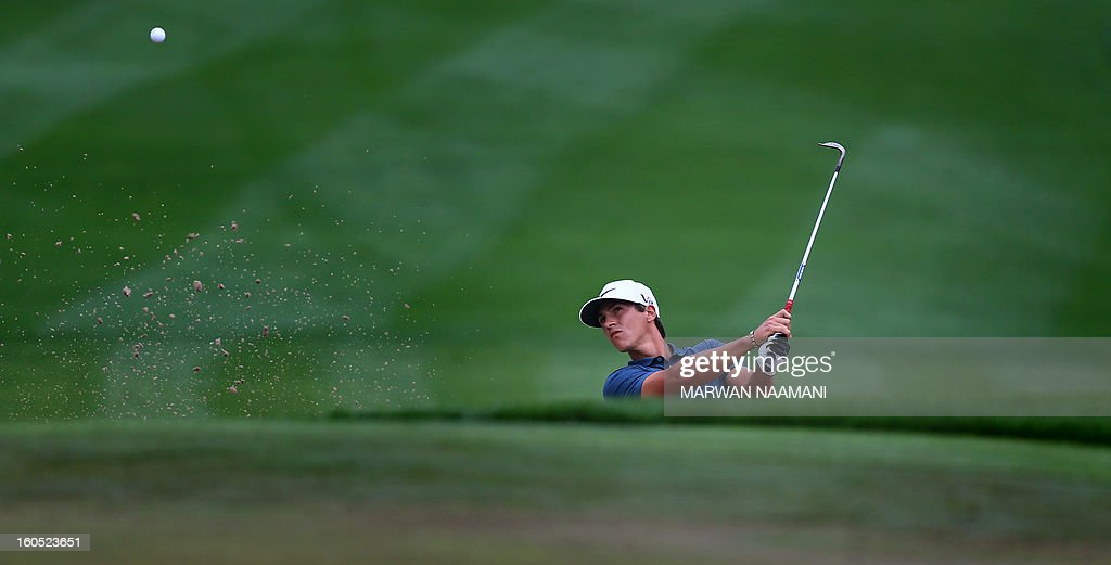 Thorbjorn Olesen of Denmark plays a shot from the bunker during the third round of the Dubai Desert Classic golf tournament in Dubai on February 2, 2013.