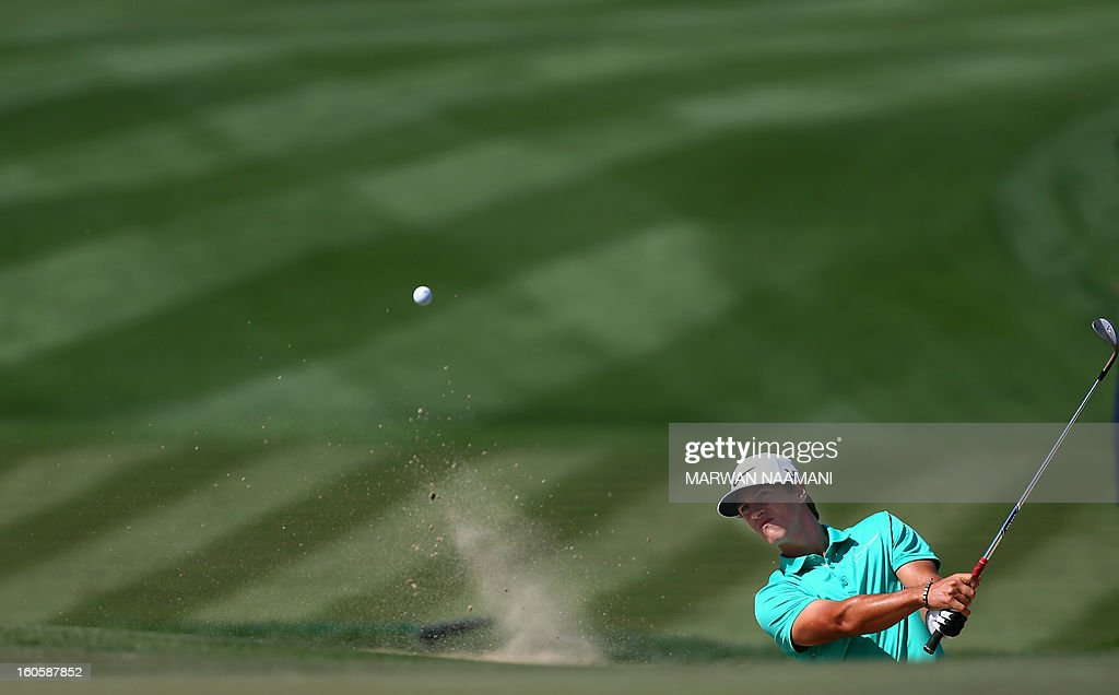 Thorbjorn Olesen of Denmark plays a shot from the bunker on the fouth and last round of the Omega Dubai Desert Classic in Dubai, on February 3, 2013.