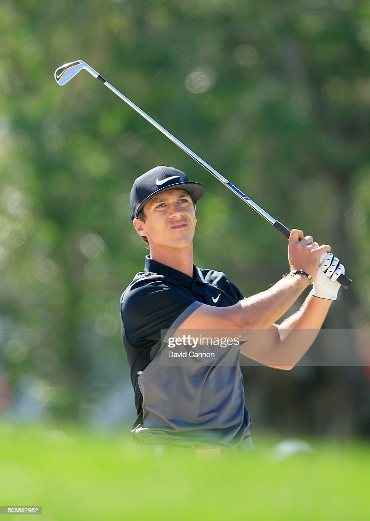 <a gi-track='captionPersonalityLinkClicked' href=/galleries/search?phrase=Thorbjorn+Olesen&family=editorial&specificpeople=6545194 ng-click='$event.stopPropagation()'>Thorbjorn Olesen</a> of Denmark plays his second shot at the par 4, first hole during the third round of the 2016 Omega Dubai Desert Classic on the Majlis Course at the Emirates Golf Club on February 6, 2016 in Dubai, United Arab Emirates.
