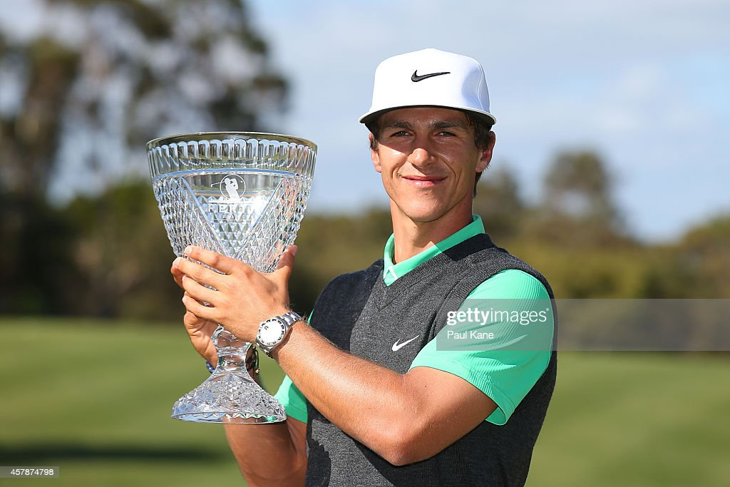 <a gi-track='captionPersonalityLinkClicked' href=/galleries/search?phrase=Thorbjorn+Olesen&family=editorial&specificpeople=6545194 ng-click='$event.stopPropagation()'>Thorbjorn Olesen</a> of Denmark poses with the trophy after winning the 2014 Perth International at Lake Karrinyup Country Club on October 26, 2014 in Perth, Australia.