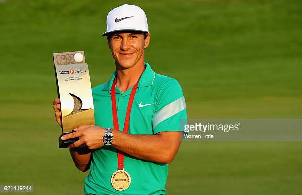 Thorbjorn Olesen of Denmark poses with the trophy following his victory during the final round of the Turkish Airlines Open at the Regnum Carya Golf...