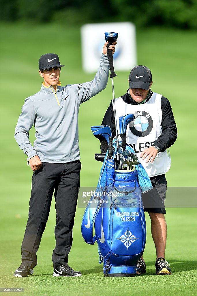 <a gi-track='captionPersonalityLinkClicked' href=/galleries/search?phrase=Thorbjorn+Olesen&family=editorial&specificpeople=6545194 ng-click='$event.stopPropagation()'>Thorbjorn Olesen</a> of Denmark pulls a club during the rain delayed third round of the BMW International Open at Gut Larchenhof on June 26, 2016 in Cologne, Germany.