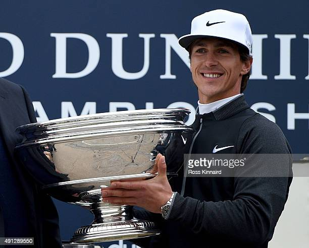 Thorbjorn Olesen of Denmark receives the trophy on the 18th green after victory in the 2015 Alfred Dunhill Links Championship at The Old Course on...